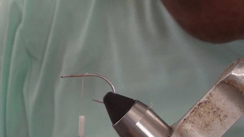 Tie in tan thread on SC-15 hook to about the middle of the shank.