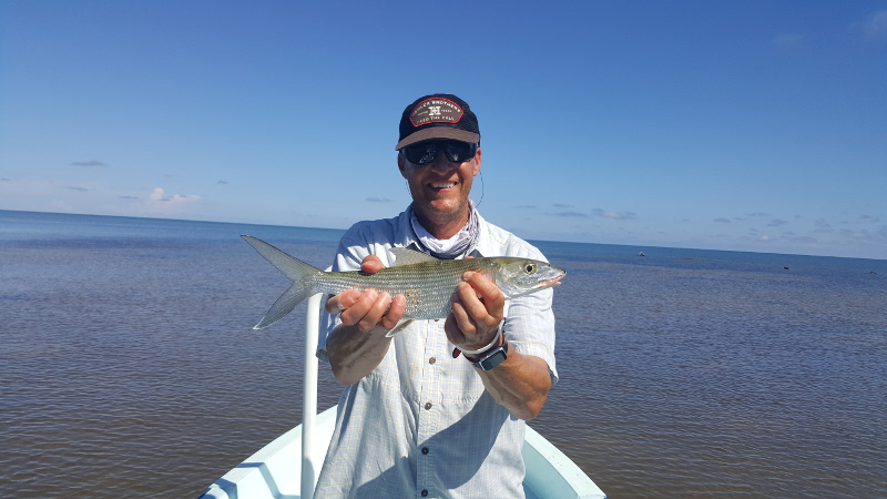Andy with a bonefish, on a beach side flat in Xcalak, Mexico Grand Slam fly fishing