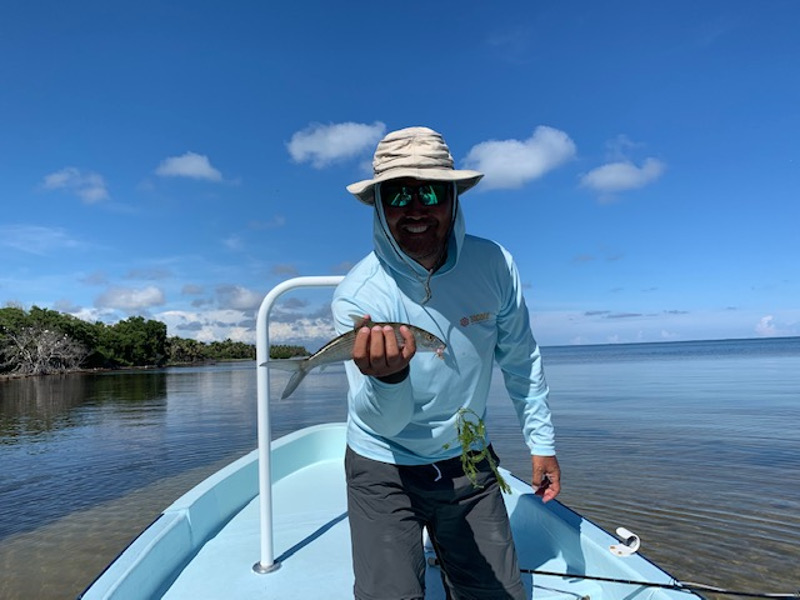 Rob with ridiculously small bonefish, on a beach side flat in Xcalak, Mexico Super grand slam fly fishing.