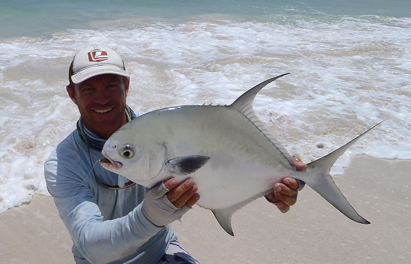 Permit on the beach with Nick Denbow